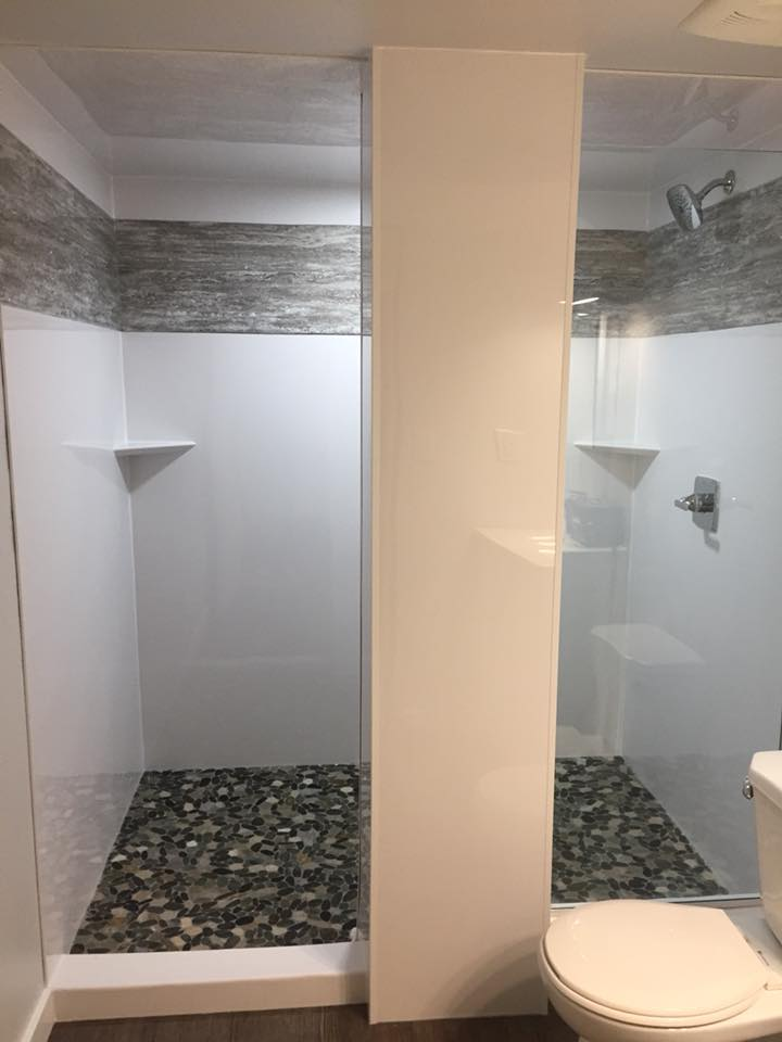 Shower with a Stone floor by Cassidy Dahl, Dahl Tubs, Prince George